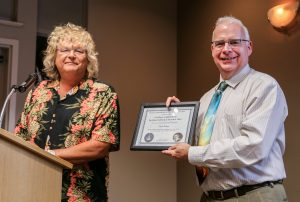 Chris Purse receives his Certificate of Appreciation for public outreach at the DAO from Sherry Buttnor