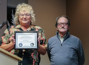 Sherry Buttnor receives her Certificate of Appreciation for publ