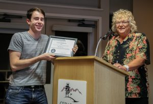 Matt Watson receives his Certificate of Appreciation for the live broadcasts of the meetings from Sherry Buttnor