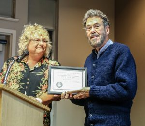 Jim Stillburn receives the Ernie Pfannenschmidt Award in Amateur Telescope Making from Sherry Buttnor for building his Poncet Telescope tracking system