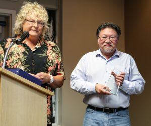 David Lee receives his Award of Excellence for organizing the speaker series for the DAO Summer Star Parties from Sherry Buttnor