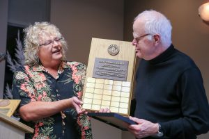 Nelson Walker receives the Newton Ball Service Award from Sherry Buttnor