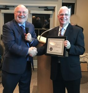 President Chris Purse receiving the Ernie Phanneshmidt Award from Vice-president Reg Dunkley